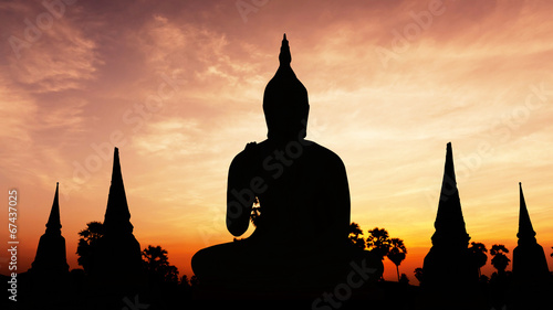Photo sur Toile Edifice religieux Statue on twilight time