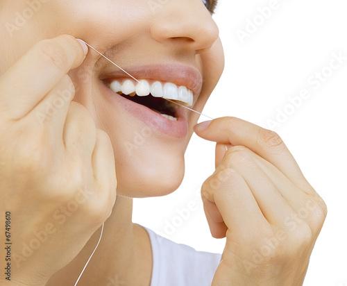Valokuva  Woman and teeth floss