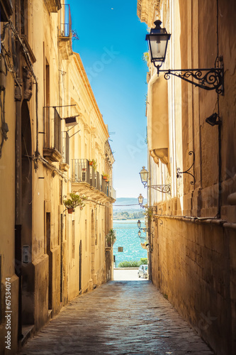 Canvas Prints Narrow alley street of Syracuse leading to the sea