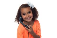 Little Girl Speaking Over Phone