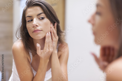 Woman taking care of her skin Canvas Print