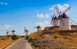 Ancient windmills in the sunny summer day, Konsuegra, Spain