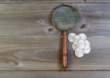 Silver Dollar Coin Collection And Round Vintage Magnify Glass On