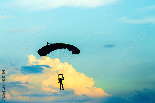 Fotografie, Obraz  unidentified skydiver, parachutist on blue sky