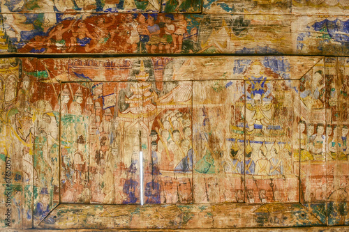 Pale and ruin Thai painting in Pratart Lampangluang Temple,Thail