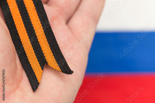Fotografia  St. George ribbon and Russian flag