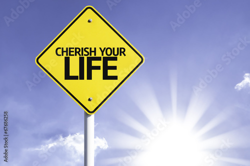 Valokuva  Cherish your Life road sign with sun background