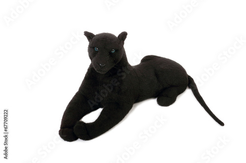 Photo Stands Panther Cute black panther soft toy with long tail lies isolated