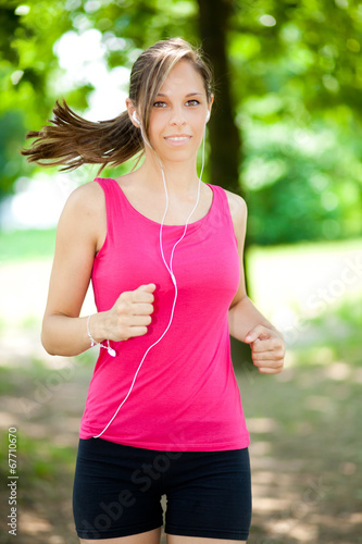 Valokuva  Young woman running at the park