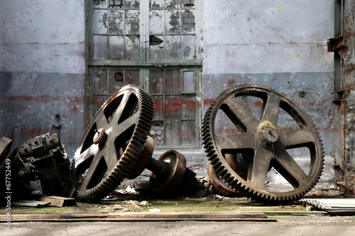 Photo Stands Old abandoned buildings rusty old metal gadgets in an abandoned ship factory