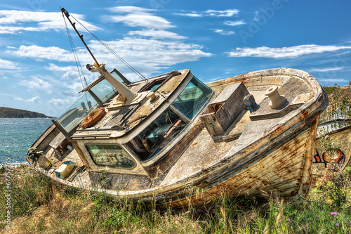 Photo Stands Shipwreck Abandoned beached boat in Mykonos