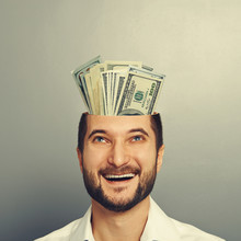 Businessman Looking Up At Money