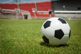 Fototapeta Sport - Soccer ball in the goal