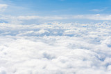 Clouds and sky, aerial view from airplane window.