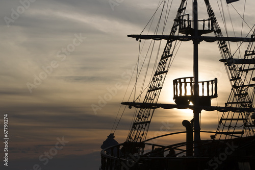 Valokuvatapetti Silhouette of sails of an antique ship, masts and bowsprit of a