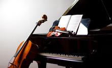 Classical Music Concept: Cello, Violin, Piano And A Score