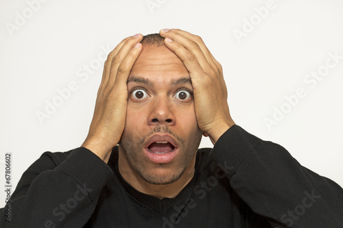 Mixed race male in absolute shock, awe and disbelief Fototapet