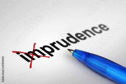 Photo Changing the meaning of word. Imprudence into Prudence.