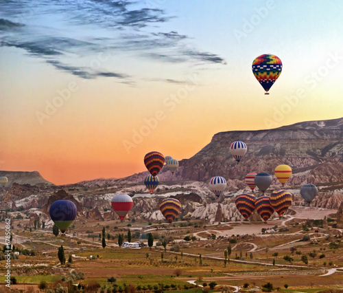 Balloons Hot air balloon flying mountain valley Göreme National Park and the Roc Canvas Print