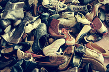 Second Hand Shoes In A Flea Market, With A Retro Filter Effect
