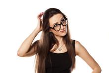 Unsure Young Woman Scratching ...