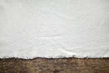 Old White Cotton Tablecloth On Wooden Table