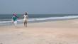Young and cute couple joy on the beach. Honeymoon near ocean.