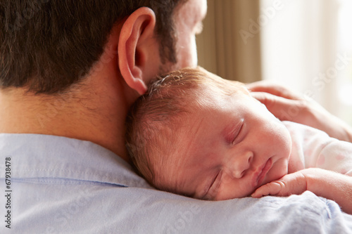Photo  Father At Home With Sleeping Newborn Baby Daughter