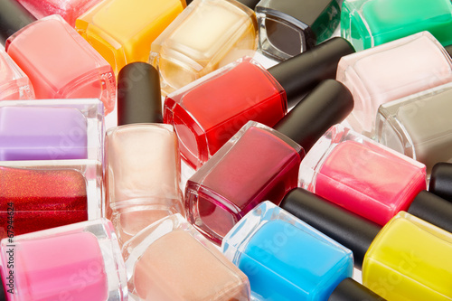 Nail polish colorful bottles background Poster