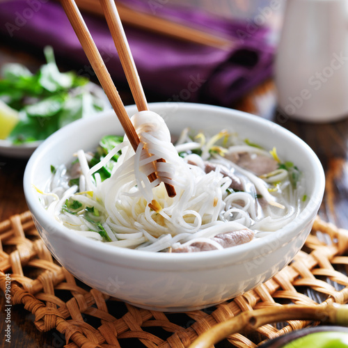 eating a bowl of pho with chopsticks Canvas Print