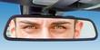 canvas print picture - Augen im Rückspiegel eines Autos