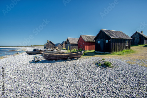 Photo  Helgumannens fishing village on Faro island in the Baltic sea