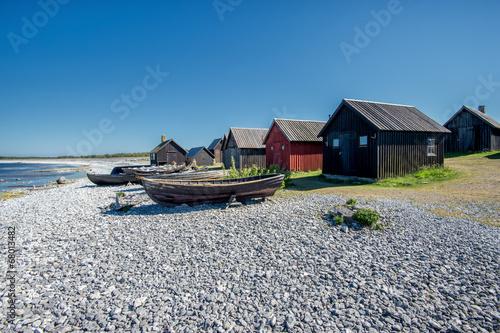 Photo  Helgumannens fishing village on Faro island in the Baltic sea