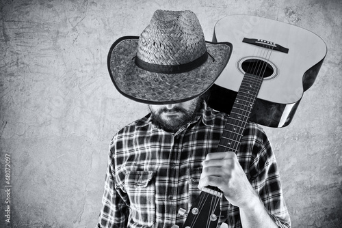 Fotografia  Western country cowboy musician with guitar