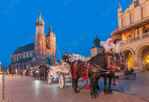 Fototapeta Carriages before the Sukiennice on The Main Market in Krakow obraz