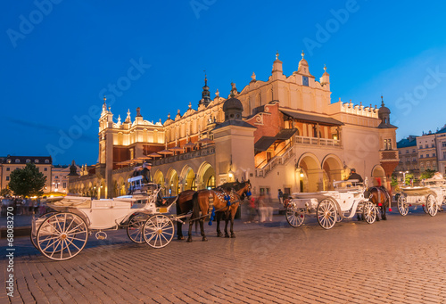 Fototapeta Carriages before the Sukiennice on The Main Market in Krakow obraz
