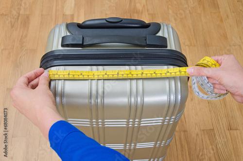 Fotografie, Obraz  Hand luggage measurement using measuring tape.