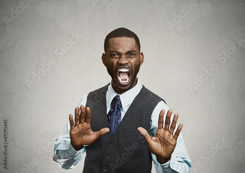 Valokuva  Angry executive gesturing with hands to stop, grey background