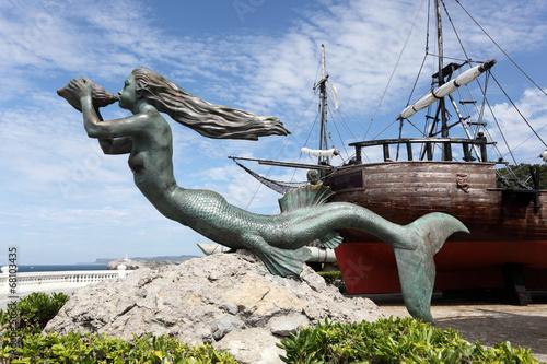 Fotografie, Tablou Mermaid sculpture at historic ship in Santander, Spain