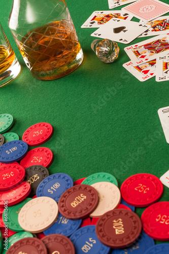 Gambling table and poker chips плакат