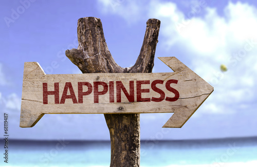 Photo  Happiness wooden sign with a beach on background