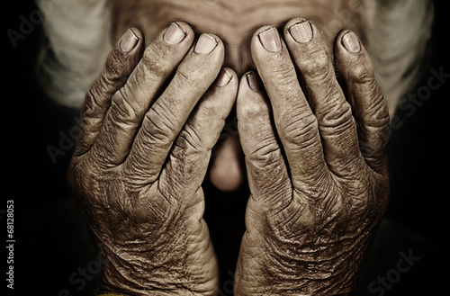 Closeup portrait depressed old woman covering her face with hand Slika na platnu