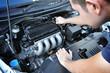 A mechanic checking car engine