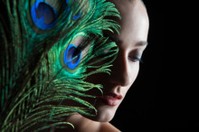 Beautiful Brunette Young Woman With Peacock Style Make-up And Pe