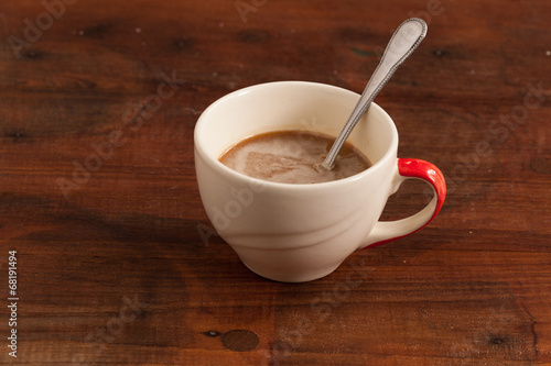 Poster Chocolate coffee cups on wood background.