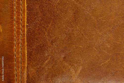 Deurstickers Leder Brown leather texture closeup.