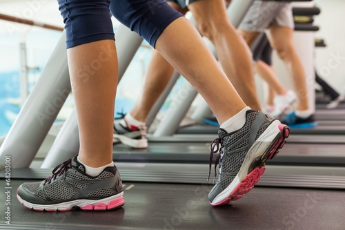 Foto op Plexiglas Fitness Row of people working out on treadmills