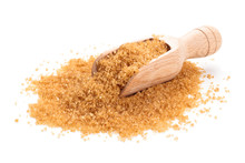 Brown Sugar In Scoop. Isolated...