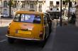 Retro car orange color purity in the street
