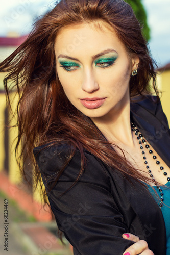 Photo  sexy girl with big lips with bright makeup walking the streets